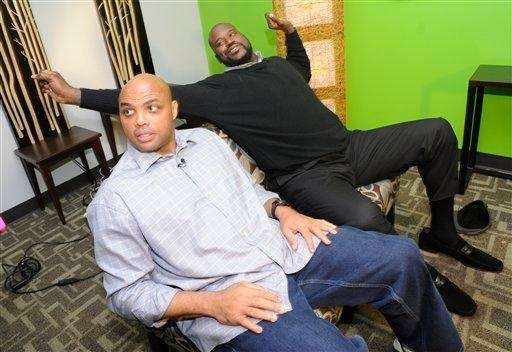 Charles Barkley, left, and Shaquille O'Neal wrap up