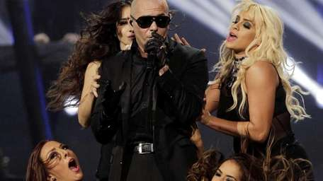 Rapper Pitbull performs during the halftime show of