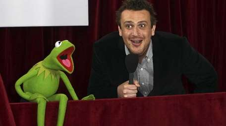 Comedian Jason Segel, right, and Kermit the frog