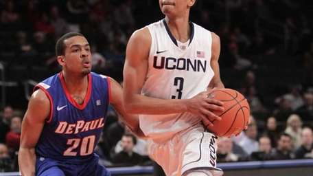 Connecticut's Jeremy Lamb moves around DePaul's Brandon Young