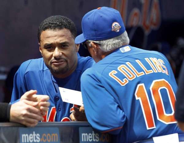 Mets starting pitcher Johan Santana, left, talks with