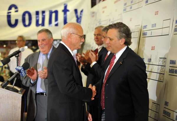 Nassau County Executive Ed Mangano, right, congratulates Joe