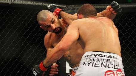 Constantinos Philippou, left, and Court McGee exchange punches