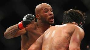 Demetrious Johnson and Ian McCall fight during the