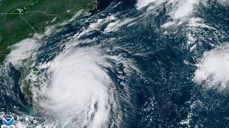 Hurricane Dorian sits over the Bahamas early on