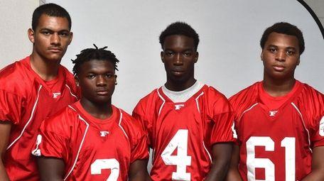 Freeport teammates, from left, Arnold Cruz, Jayvian Allen,