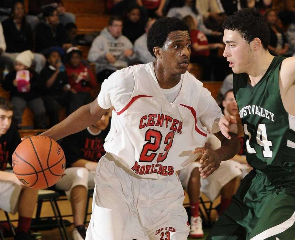 Center Moriches' Maleek Harris drives around Locust Valley's