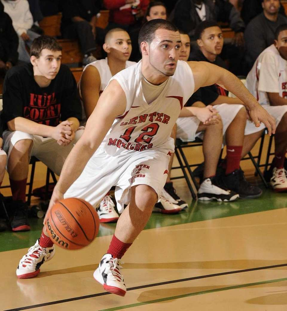 Center Moriches' Wayne Harris drives tot he basket