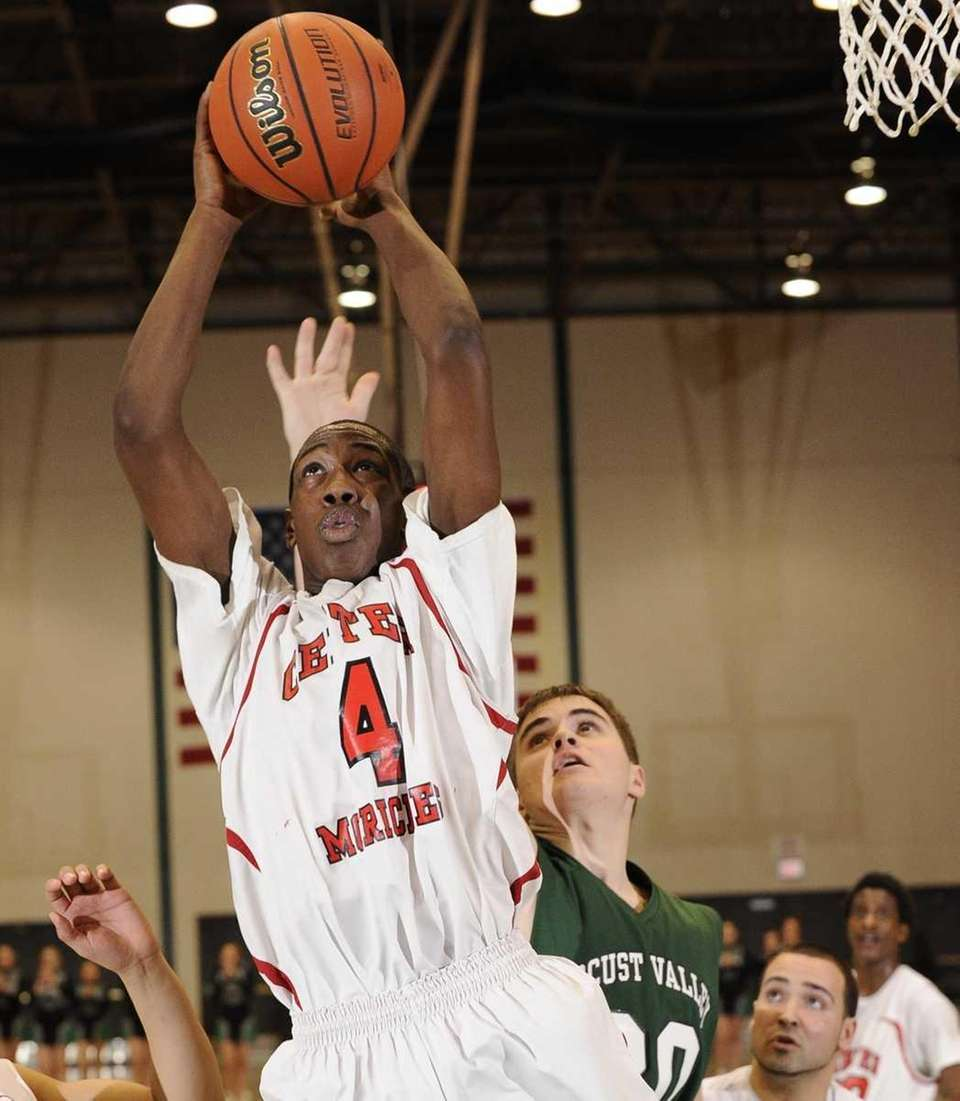 Center Moriches' Akyse Brown grabs a rebound against