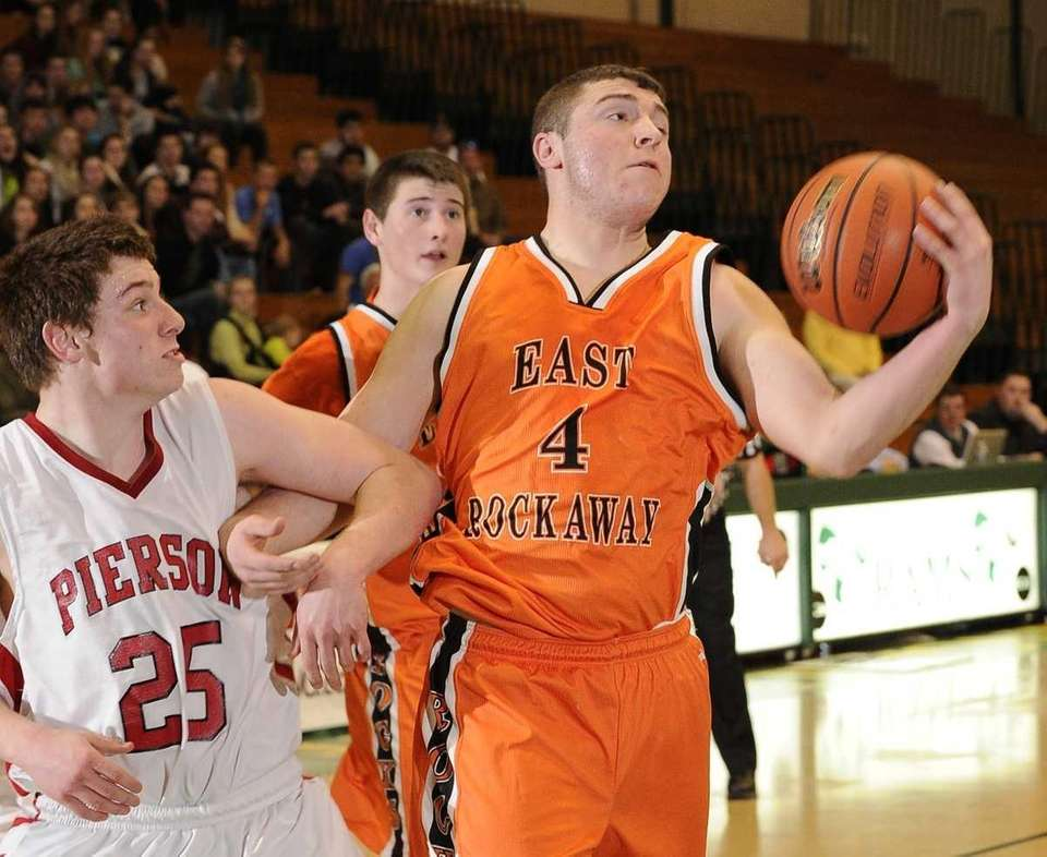 East Rockaway's David McClure grabs a rebound and