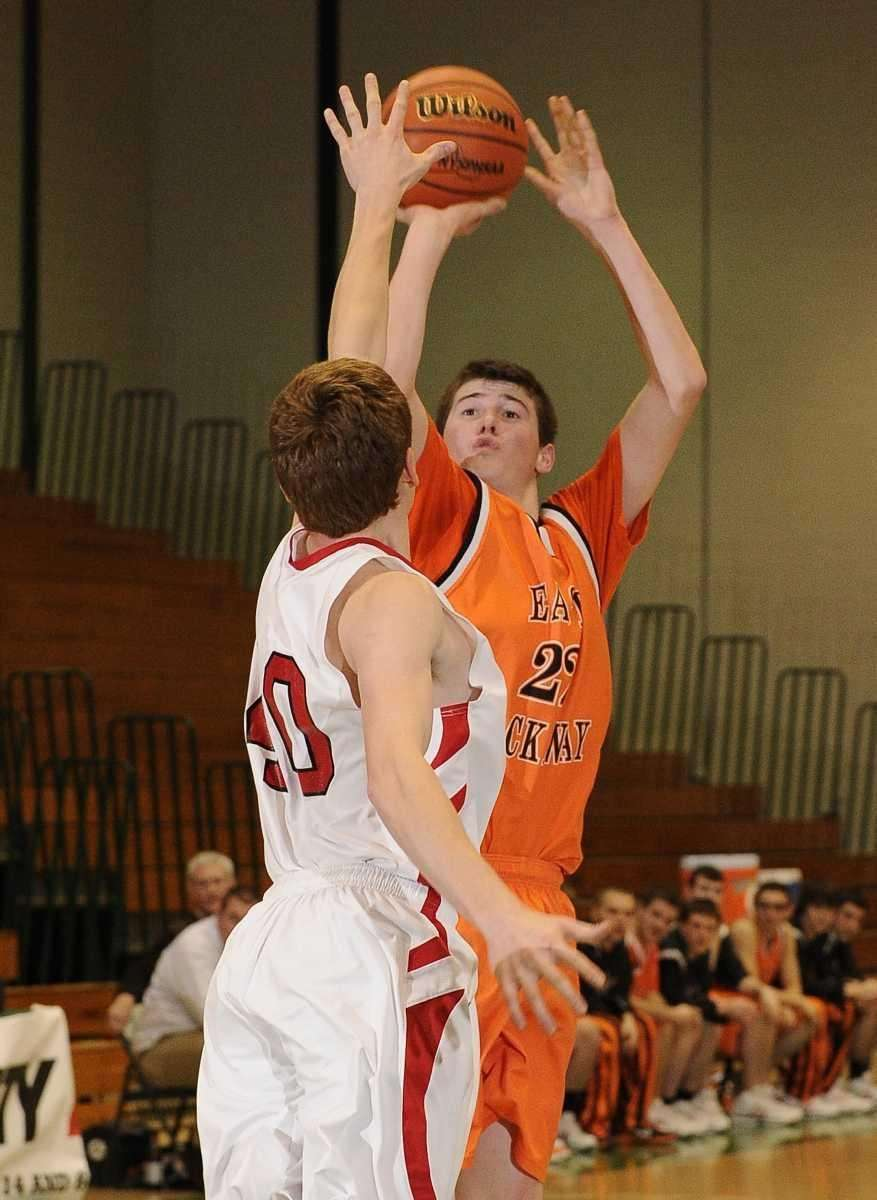 East Rockaway's Justin Jonas shoots under pressure from