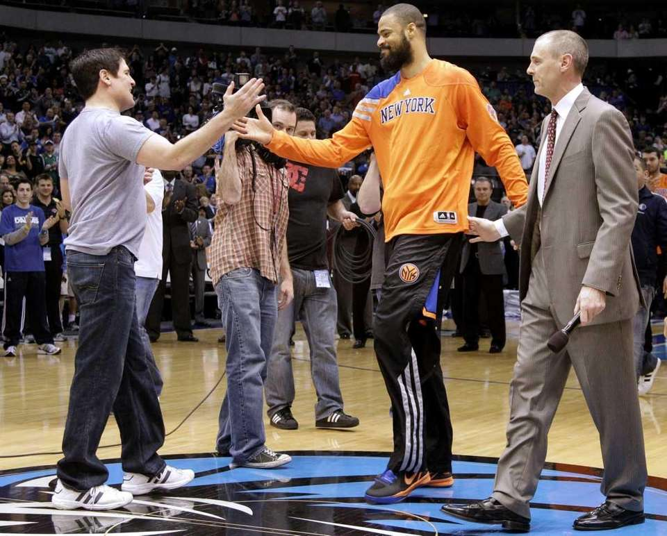 Dallas Mavericks team owner Mark Cuban, left, and