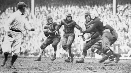 Chicago's Red Grange, left, about to make a