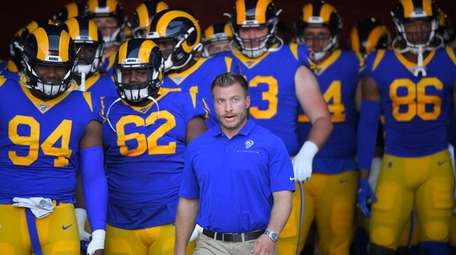 Los Angeles Rams head coach Sean McVay enters
