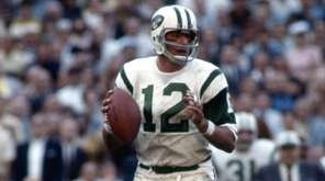 Joe Namath gets set to pass during Super