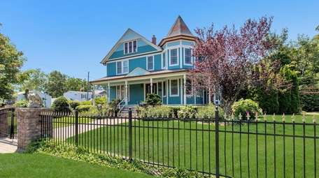 This Patchogue Queen Anne Victorian four-bedroom, 1.5-bathroom home