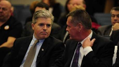 Suffolk County Executive Steve Bellone, left, and Suffolk