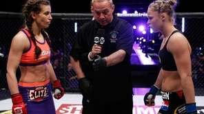 Ronda Rousey and Miesha Tate get instructions from