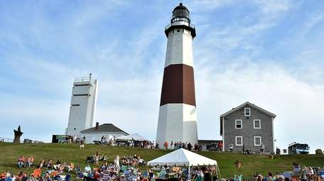 Visitors attend a concert at the Montauk Lighthouse