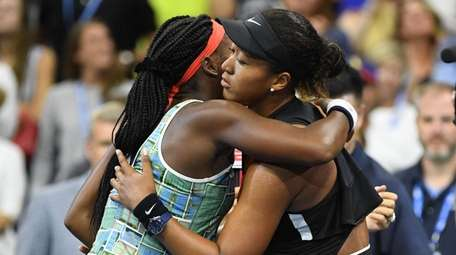 Naomi Osaka, right, embraces Coco Gauff during a