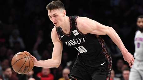 Nets forward Rodions Kurucs drives to the basket