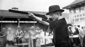Expert sharpshooter and performer Annie Oakley comes out