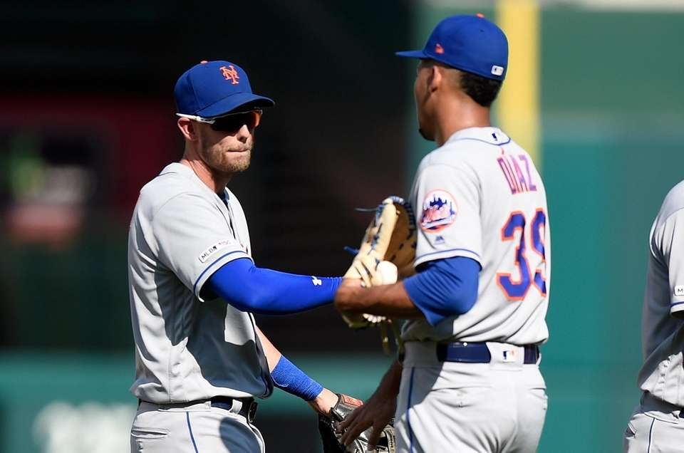 Jeff McNeil #6 and Edwin Diaz #39 of