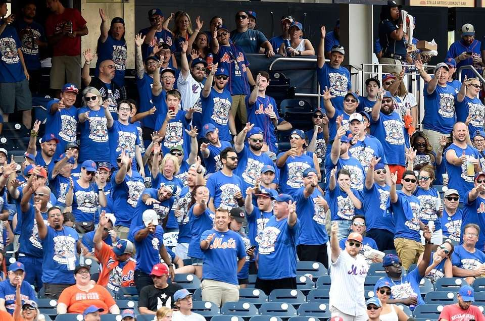 New York Mets fans cheer in the sixth
