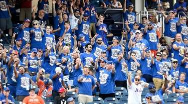 Mets fans cheer in the sixth inning of