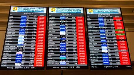 The information board displays all the canceled flights