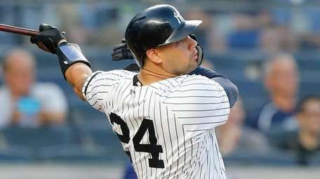 Gary Sanchez of the Yankees follows through on