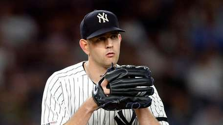 James Paxton #65 of the Yankees pitches during
