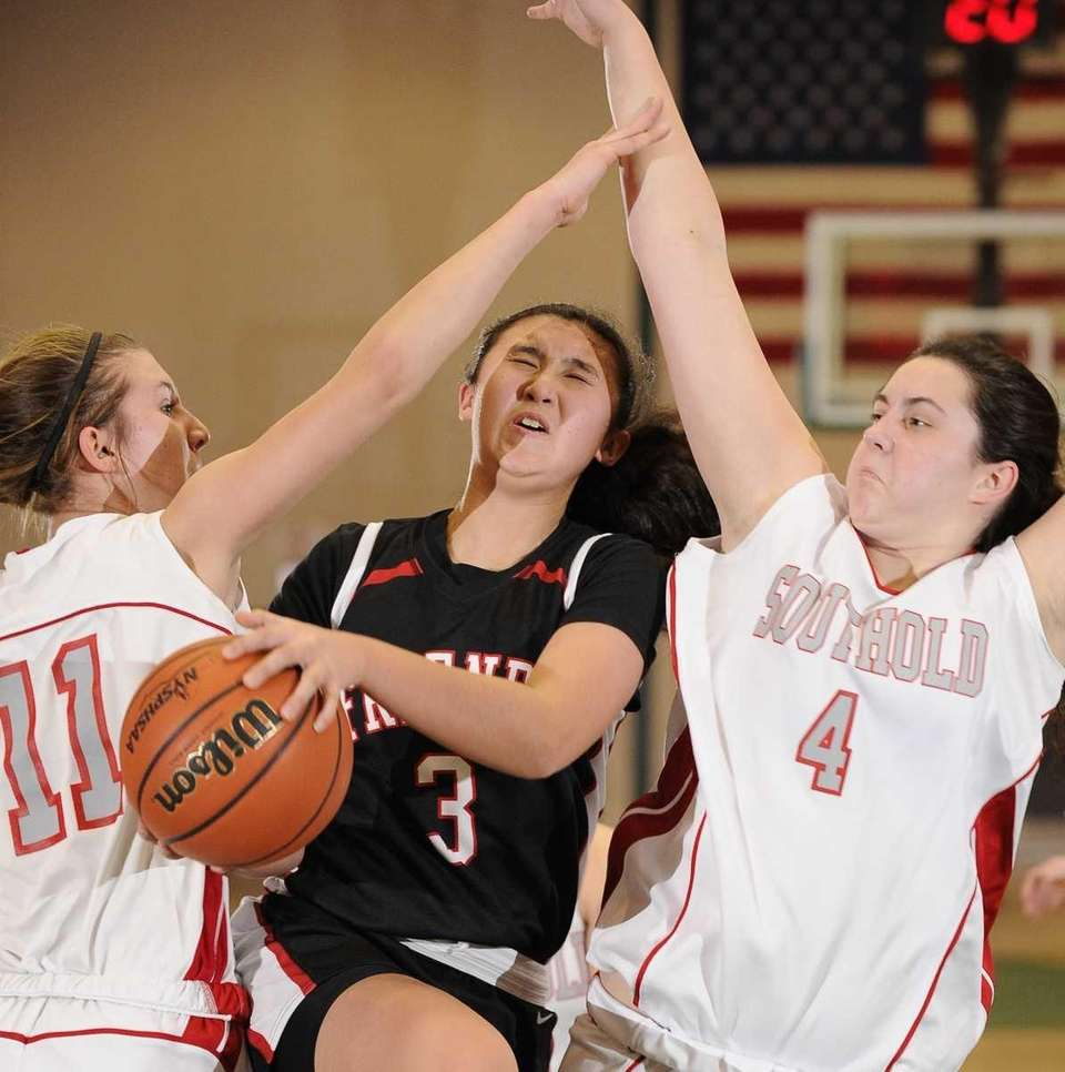 Friends Academy's Kristina Kim goes up between Southold