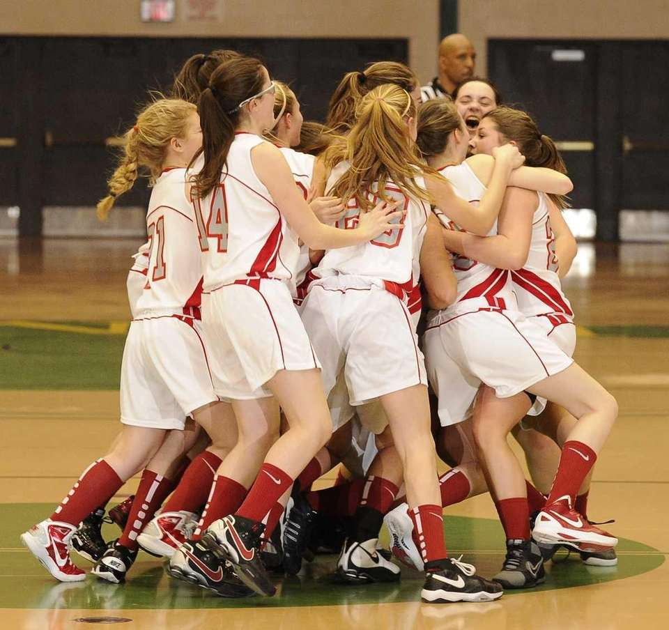 Southold celebrates their overtime win against Friends Academy