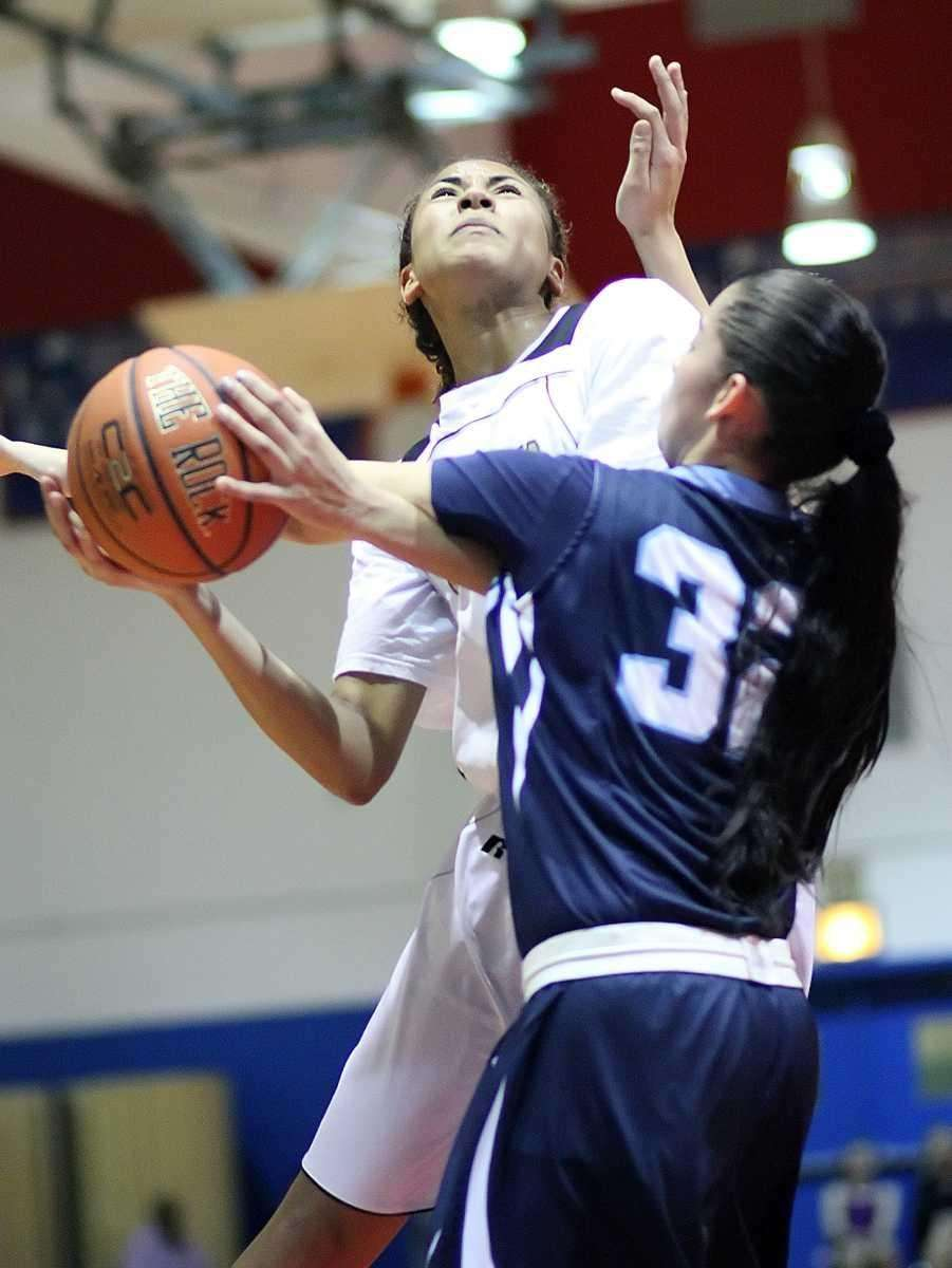 St. Anthony's Chastity Taylor goes in hard against