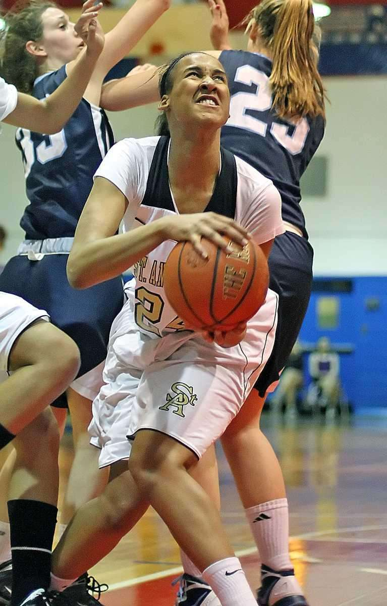 St. Anthony's Symone Kelly gets the basket during