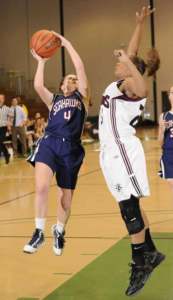 Cold Spring Harbor guard Jean Atkinson attempts a