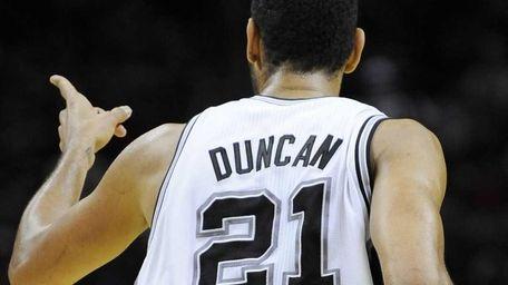 San Antonio Spurs' Tim Duncan gestures after a