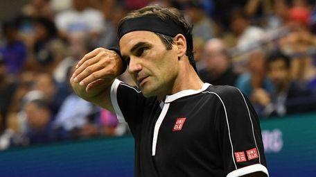 Roger Federer looks on against Grigor Dimitrov during