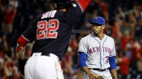Mets relief pitcher Edwin Diaz, right, walks off