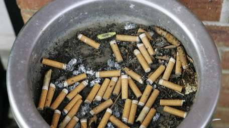 A file photo of an ashtray full of