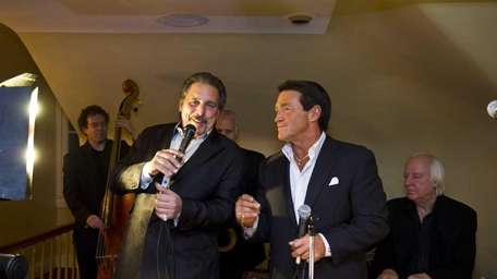 Johnny Avino, right, performs with Les Stanco and