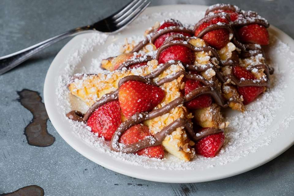 Krispy Nutella French Toast with sliced strawberries, powdered