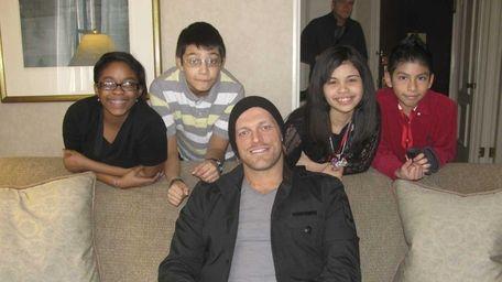 WWE wrestler Edge with Kidsday reporters: Tiffany Kennedy,
