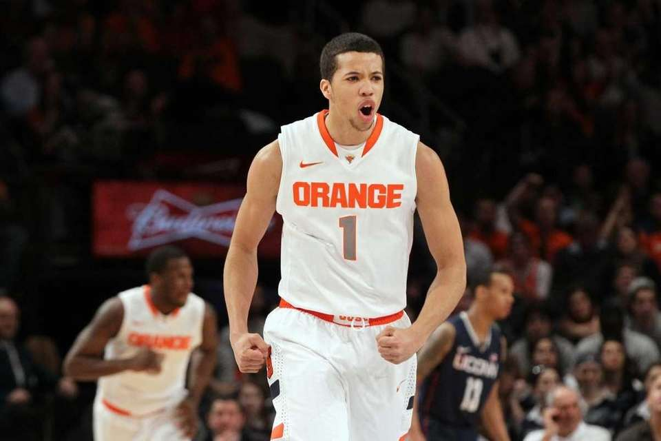 Michael Carter-Williams #1 of the Syracuse Orange reacts