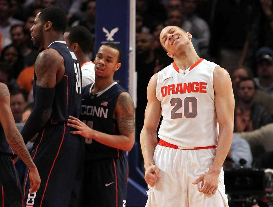 Brandon Triche of the Syracuse Orange reacts after
