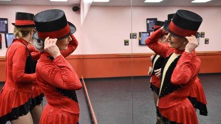 Dancer Susie Fairchild looks in a mirror as