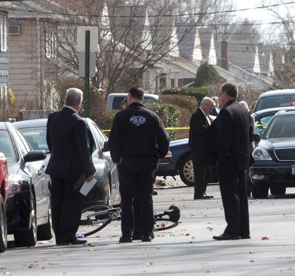 Nassau County Police investigate the scene in Massapequa