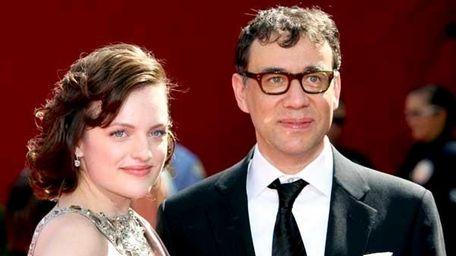 Elisabeth Moss (L) and Fred Armisen, September 2009.