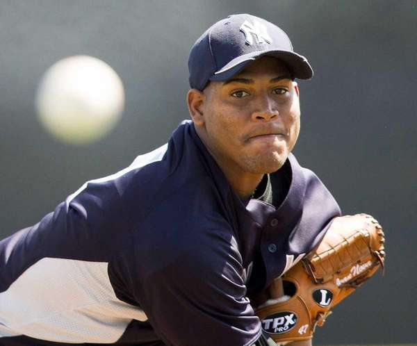 Yankees starting pitcher Ivan Nova warms up before
